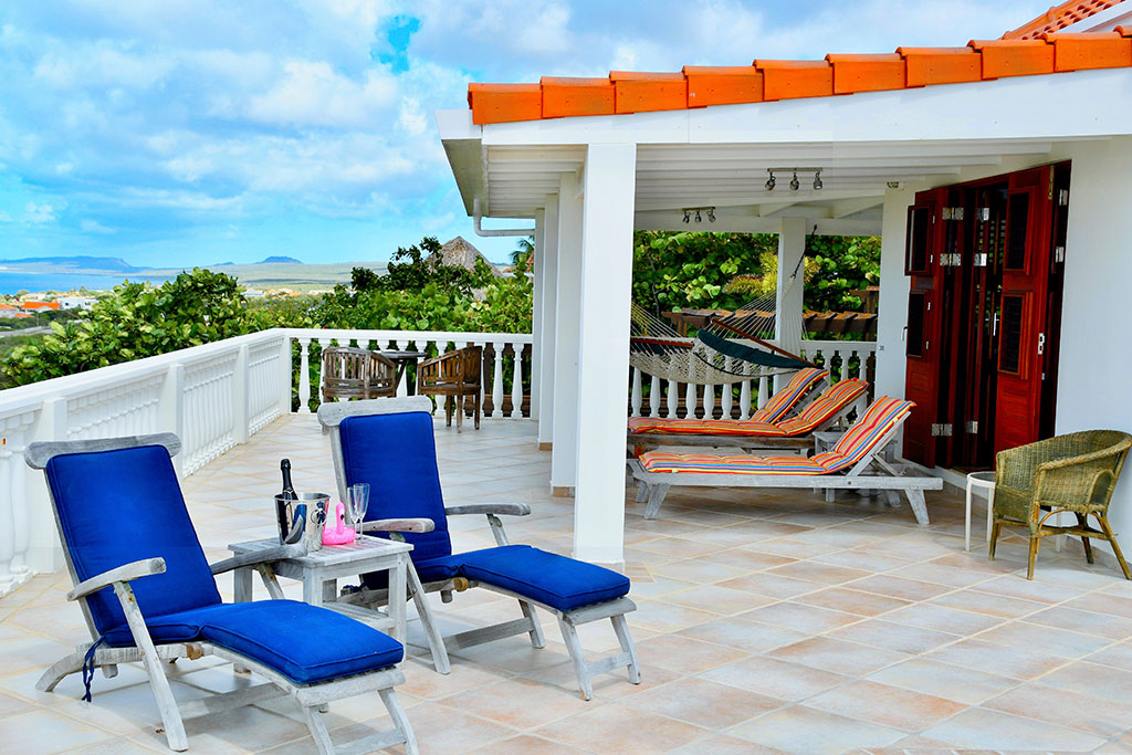 casa caribe sunbeds and porch